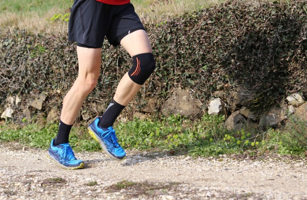 Sport injury treated by Hosford Health Clinic osteopath; cross country runner with knee brace