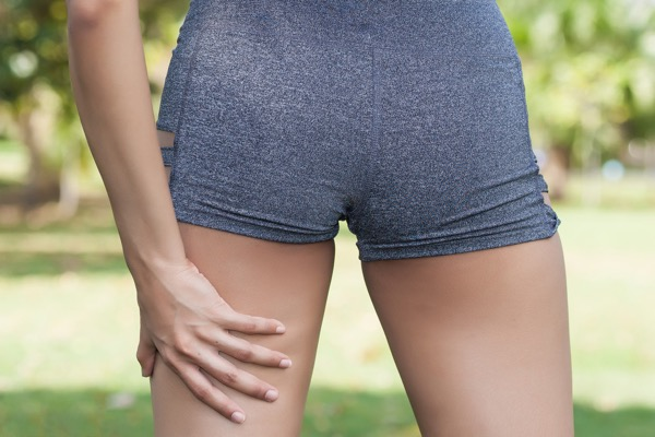 Sport injury treated by Hosford Health Clinic osteopath; female runner with hamstring strain