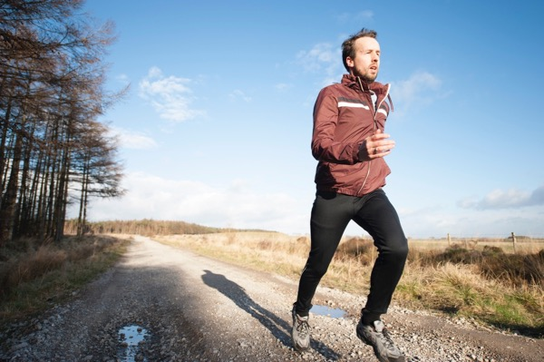 Sport injury treated by Hosford Health Clinic osteopath; jogging man on trail