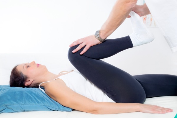 Osteopath treating a patients back and hip